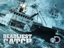 """Image of rough seas with a fishing vessel  and the Discovery Chanel """"Deadliest Catch"""" logo"""